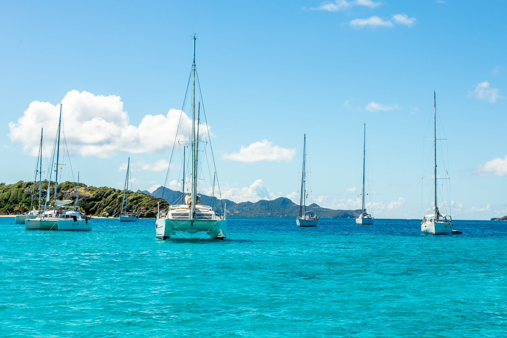 Turquoise colored sea with ancored yachts and catamarans, Tobago Cays tropical islands, Saint Vincent and the Grenadines, Caribbean sea