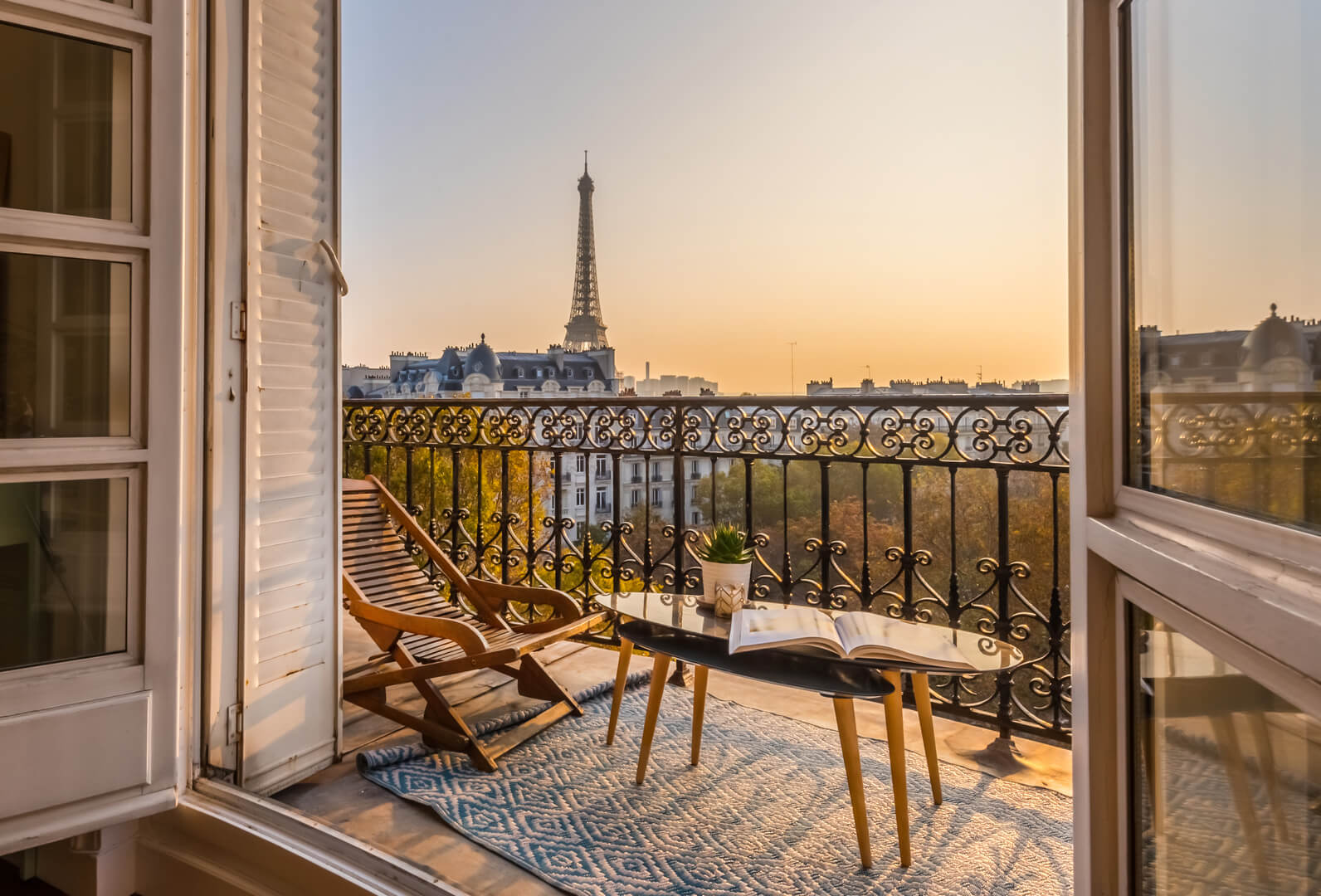 paris balcony with a splendid view of the eiffel tower at sunset