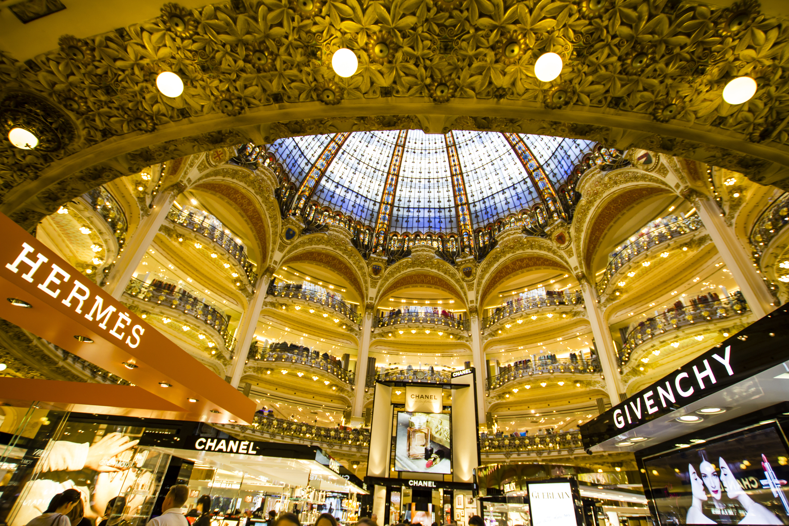 inside part of the famous Galeries Lafayette with it's brand stands Hermes, Chanel and Givenchy on April 24th 2013 in Paris, France
