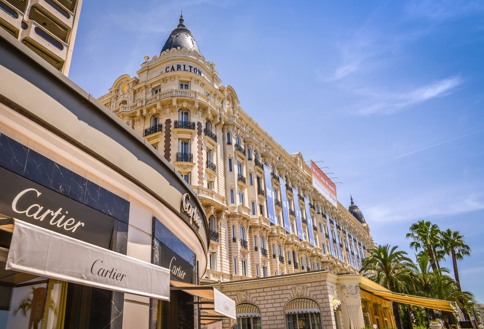 A general view of Hotel CARLTON CANNES and expensive shops along the Croisette.