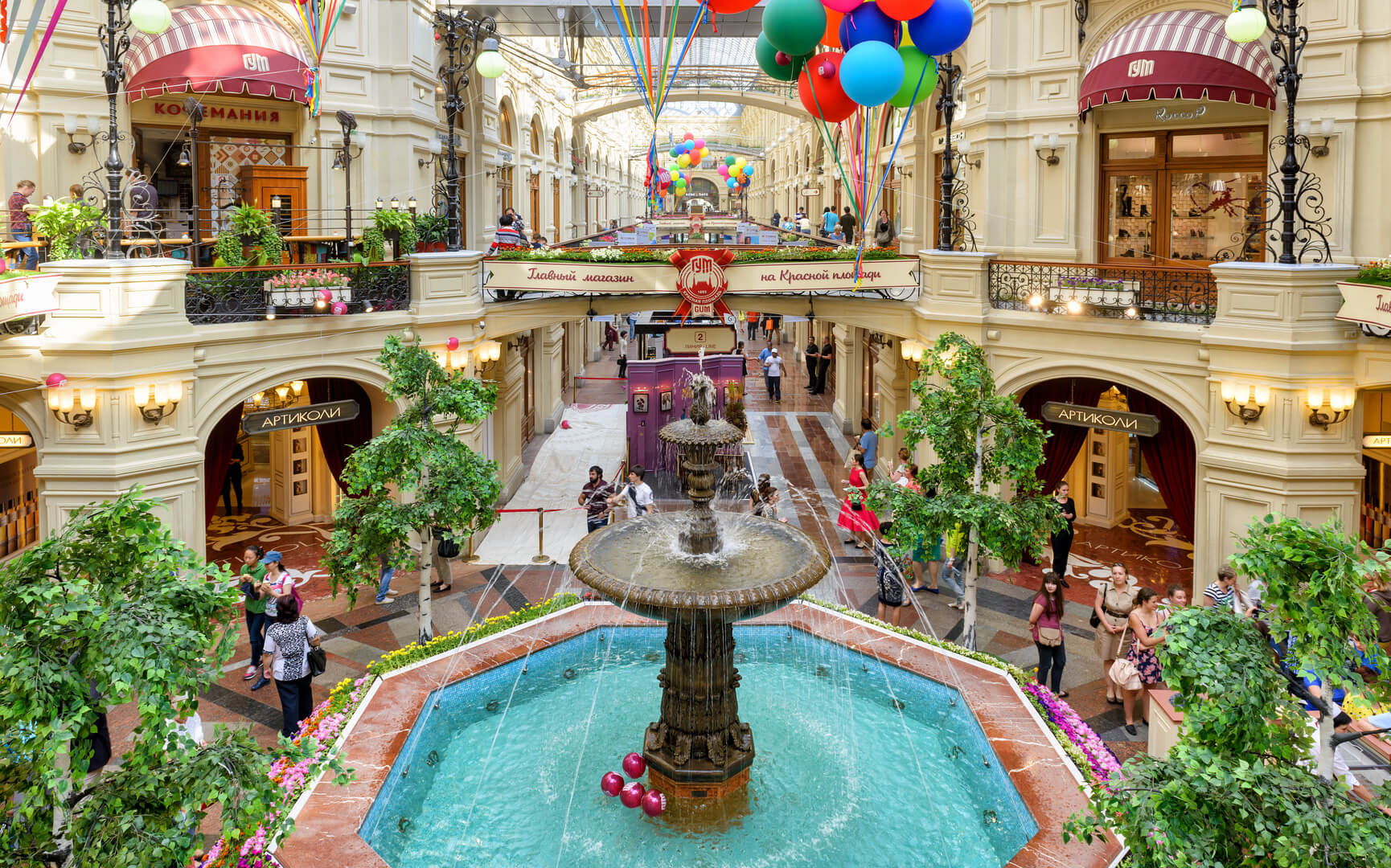 Inside the GUM (main department store) at the Red Square, Russia. GUM is one of the oldest supermarkets in Moscow and tourist attraction. Luxury interior with a nice fountain