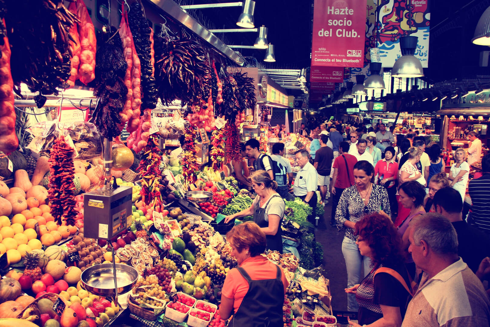 Tourists visit famous La Boqueria market in Barcelona. One of the oldest markets in Europe that still exist.
