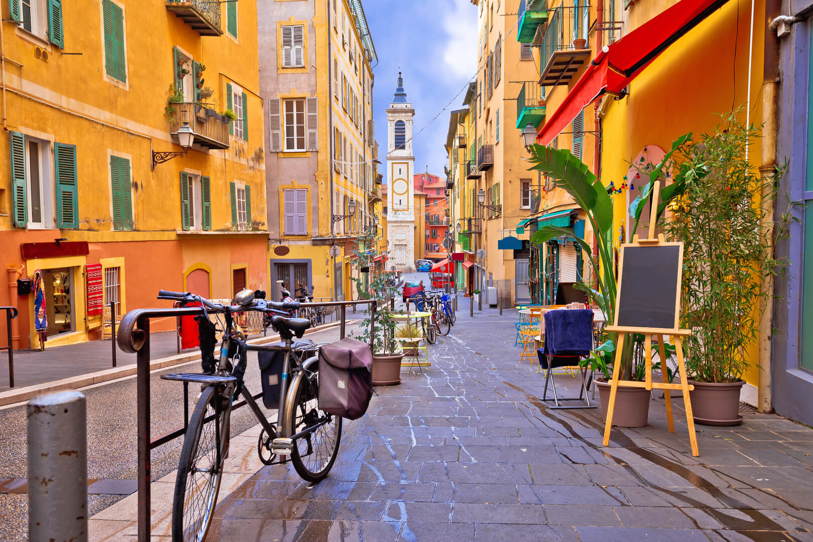 Beautiful colourful street architecture and view of the church, tourist destination of the French Riviera, Alpes Maritimes Ministry of France
