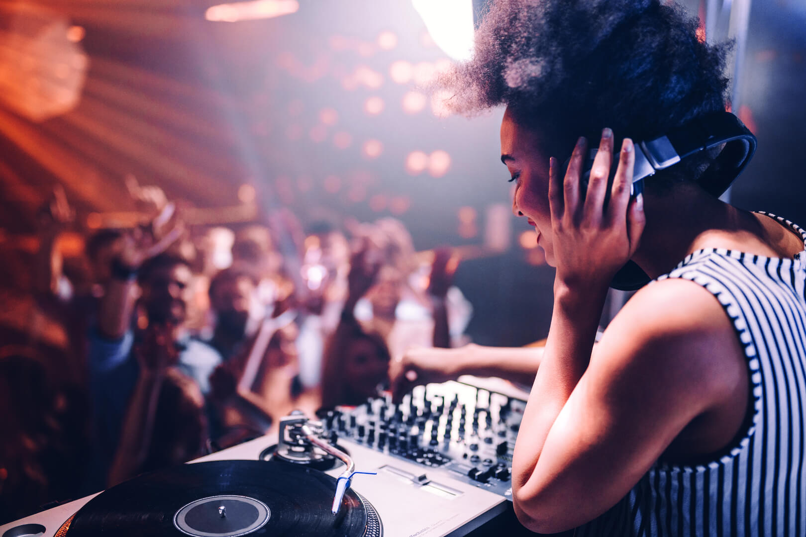 Shot of a female DJ playing music in a club in dusseldorf