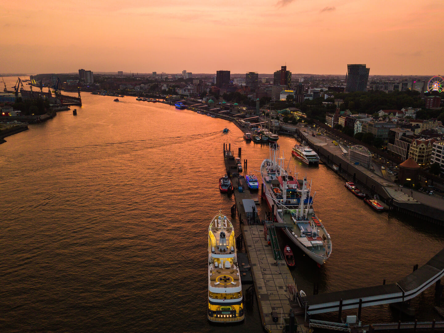 Aerial view of the Elbe River and ships in the city of Hamburg during sunset. Geramania in the summer