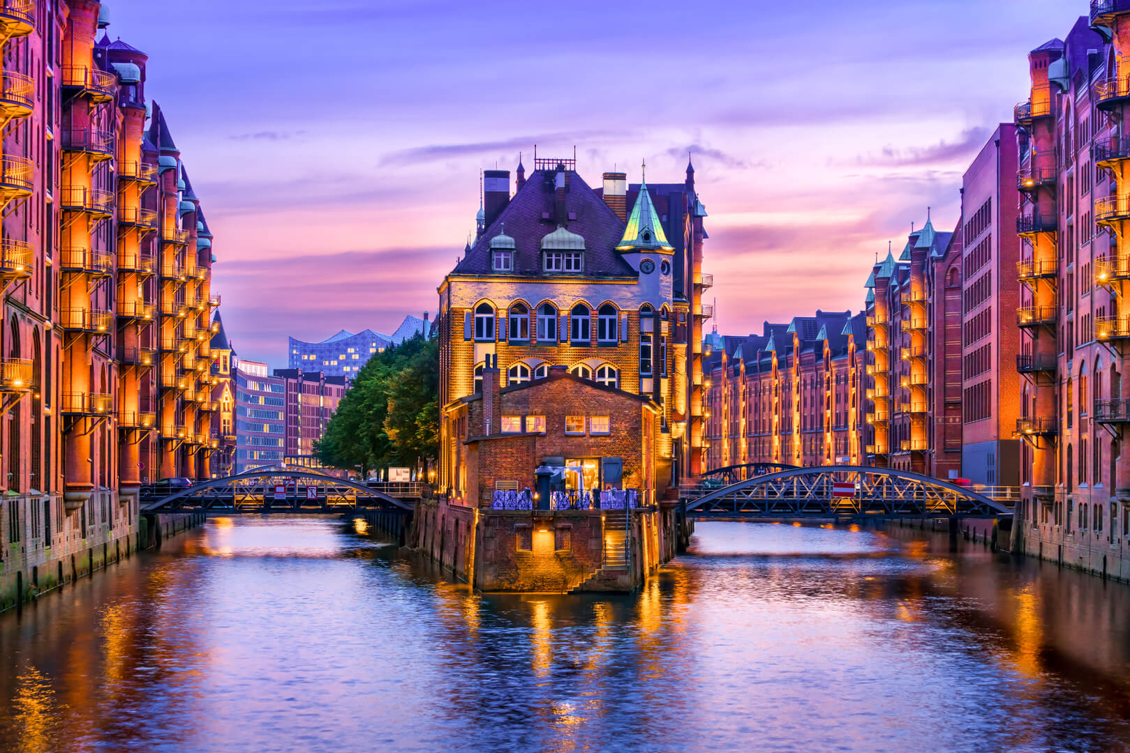 The warehouse district (Speicherstadt) in Hamburg, Germany, at dusk. View of Wandrahmsfleet. The world's largest warehouse district is located in the port of Hamburg in the HafenCity area.