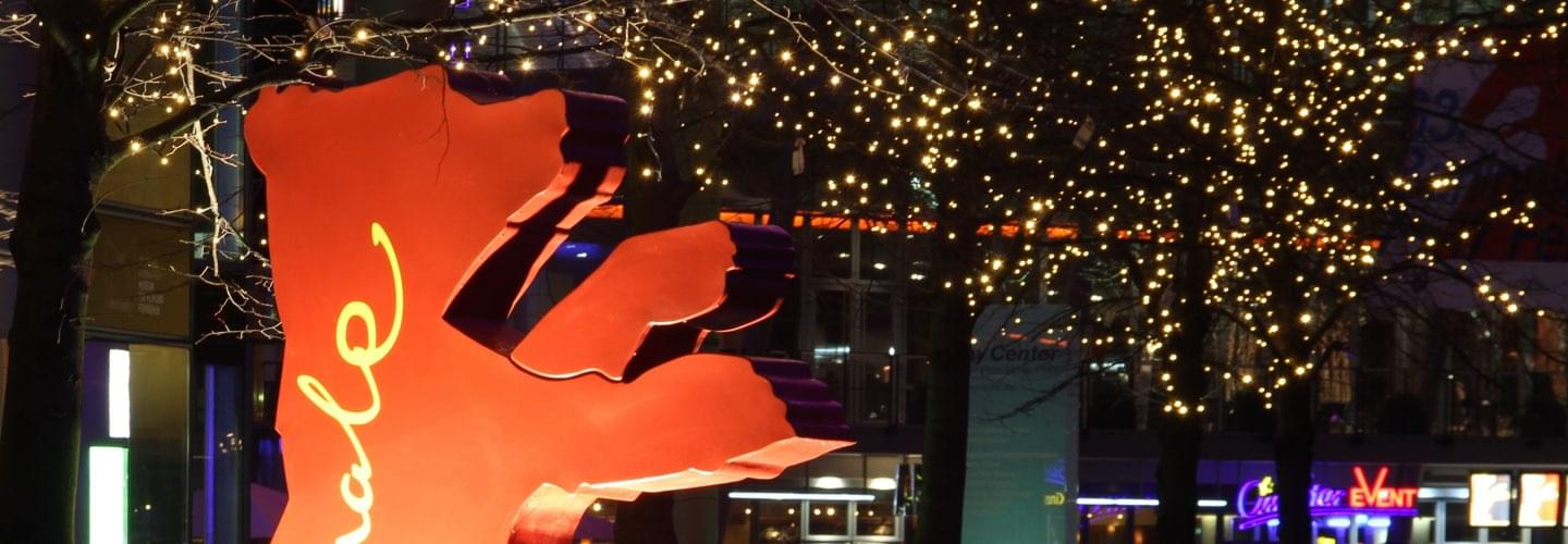 Berlinale Film Festival Awards red bear in Berlin Germany by night with light-up trees