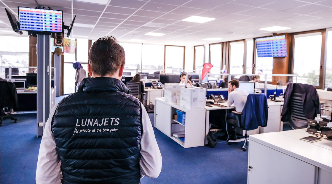LunaJets employees working in an open space office