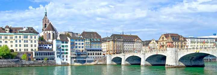 Bridge Mittlere Brücke on the Rhin with several buildings including the Martinskirche in Basel Switzerland
