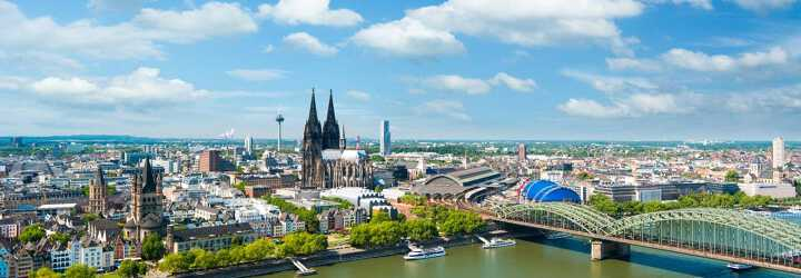 Aerial view of Cologne's Grand Gothic Cathedral with the Colonius Broadcasting Tower in background