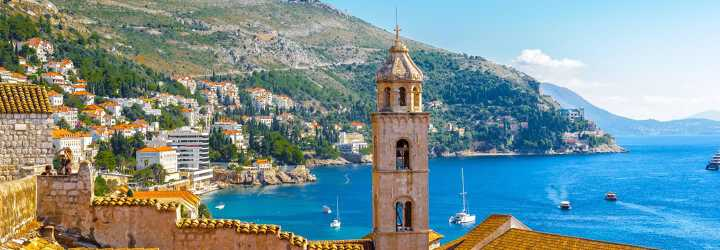 View of Dubrovnik in Croatia with the tower of the Franciscan Church and Monastery and boats