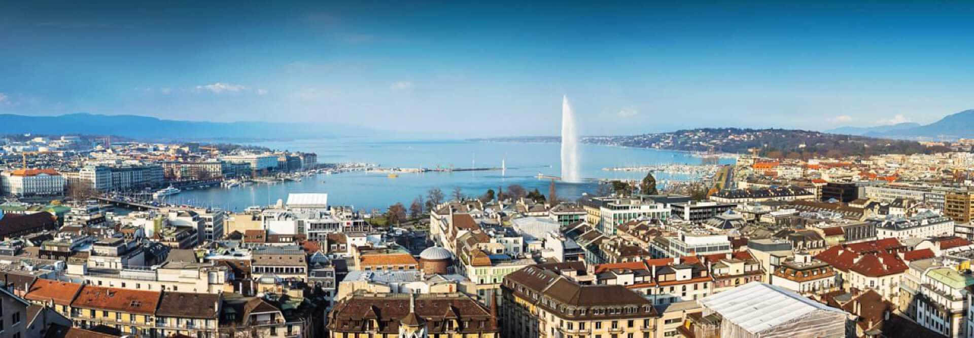 Daylight skyline of Geneva Lake with its Jet d'Eau and the Mont Blanc bridge