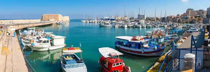 The port of Iraklion in Greece with many small fishing boats