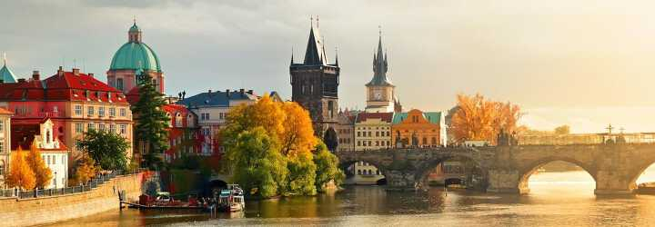 Skyline of Charles Bridge and old tower in Prague in Czech Republic in the sunset