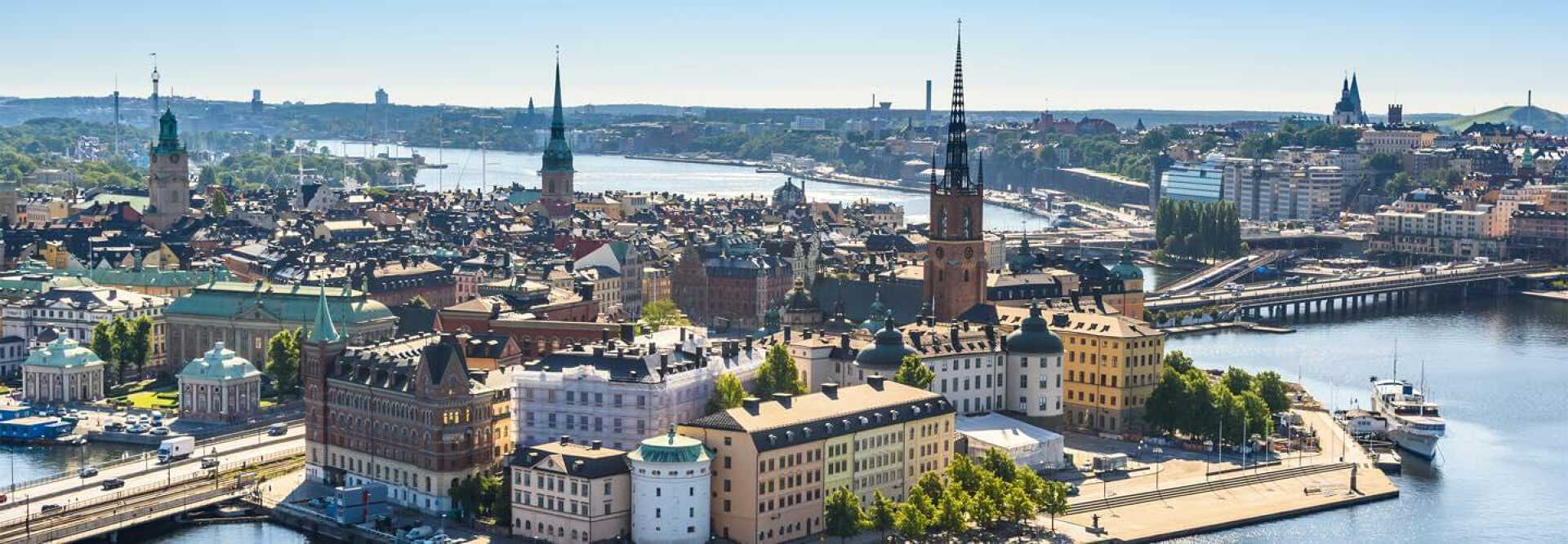 View of the old town in Stockholm in Sweden and the German church and a boat