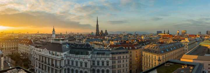 Sunset skyline from a rooftop of Vienna in Austria with the Vienna Cathedral in the background