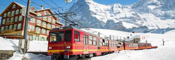 Photo of the train passing through the ski resort of Wengen in Switzerland