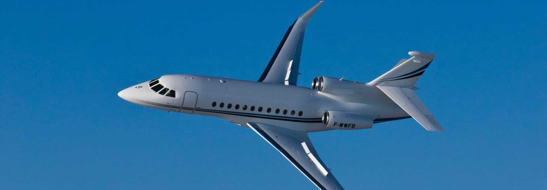 Super Large Business Jet Dassault Falcon 900EX EASy to charter for private aviation flights with LunaJets, modern exterior and a luxurious cabin