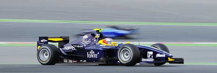 Dark blue and yellow formula one racing car at the Abu Dhabi F1 Grand Prix