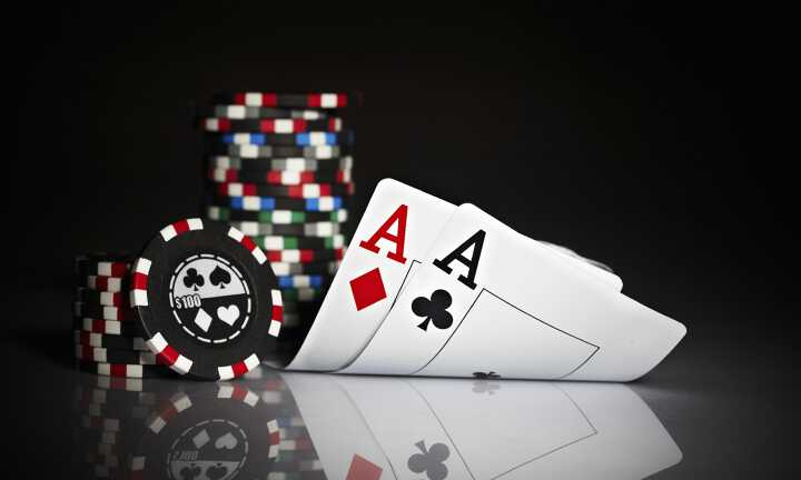 Pair of Aces and poker chips illustrating the Netjets poker tournament in Las Vegas